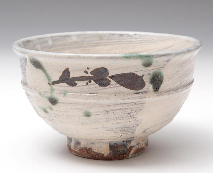 Tea Bowl, brushed slip, iron decoration & copper splashes by Jim Malone